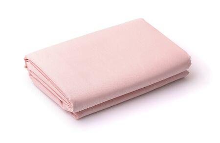 Draps de lit en coton pliés isolated on white