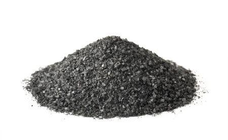 Pile of black natural salt isolated on white