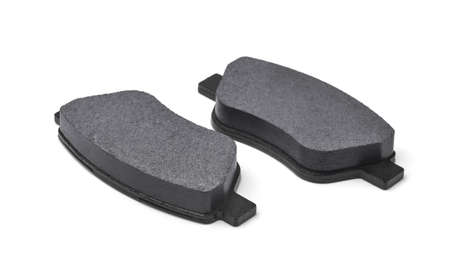 Two new car brake pads isolated on white