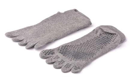 Gray non-slip yoga toe socks isolated on white Foto de archivo