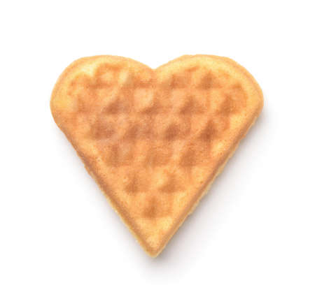 Front view of homemade heart shaped waffle isolated on white