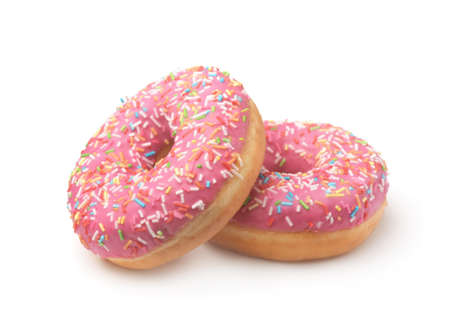 Two pink glazed doughnuts with colorful sprinkles isolated on a white