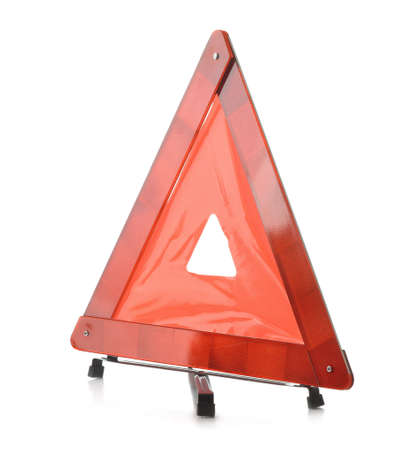 Red reflective traffic warning triangle isolated on white