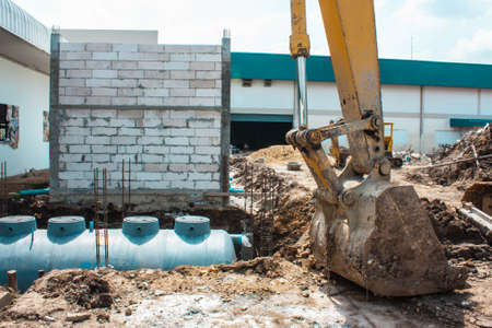 sanitary: dig a hole for sanitary tank by machine Stock Photo