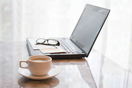 working hour: Coffee cup and laptop  for business office table concept working hour