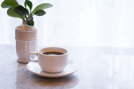 on the table: coffee cup on table