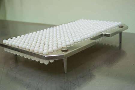 pharma: capsule filling machine in pharma or supplement  industry
