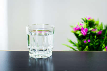 Glass of water on the table background Stock Photo