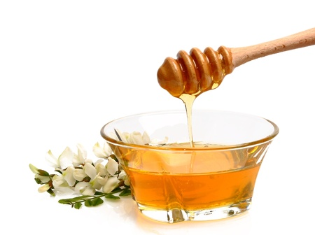 honey bee: Honey pouring Stock Photo