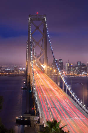 interstate 80: OAKLAND, CA - JUNE 10, 2015: The San Francisco�Oakland Bay Bridge is a complex of bridges spanning San Francisco Bay in California. As part of Interstate 80 and the direct road between San Francisco and Oakland, it carries about 240,000 vehicles a