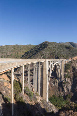 Bixby Creek Bridge, also known as Bixby Bridge, is a reinforced concrete open-spandrel arch bridge in Big Sur, California. It is one of the tallest single-span concrete bridges in the worl and one of the most photographed bridges along the Pacific Coast d Editorial