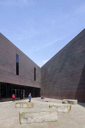integrates: SAN FRANCISCO, CA - APRIL 12, 2015: The de Young Museum re-opened in a state-of-the-art new facility that integrates art, architecture and the natural landscape in one multi-faceted destination that will inspire audiences from around the world. Designed b