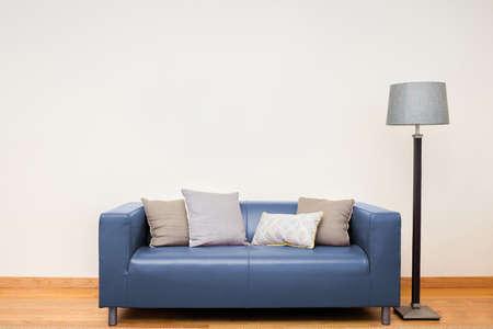blue leather sofa: Tuxedo leather sofa in blue.