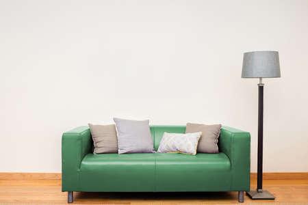 Tuxedo leather sofa in green. Stock Photo