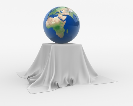 discreet: Earth globe sitting on a table cloth. 3d render illustration