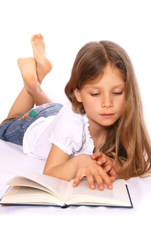 buch: Young girl with long, blond hairs is reading a book.