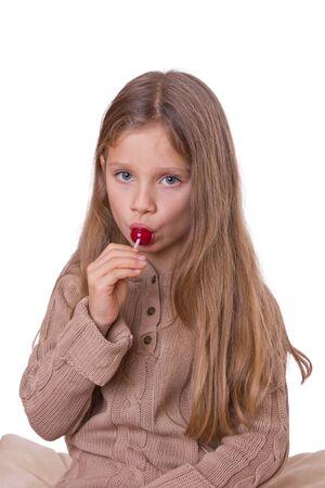 Junge, blonde Mädchen mit einem Lutscher Standard-Bild - 11673985
