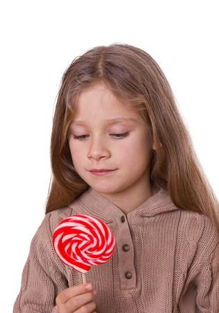 Kleine, blonde Mädchen mit einem Lutscher Standard-Bild - 11663629