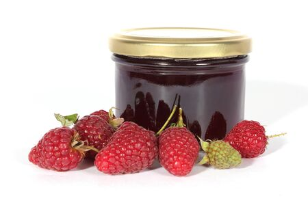 glas: Glas of jam with  fresh raspberries