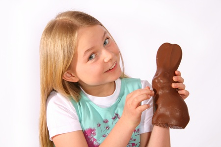 Girl with a hare of chocolate photo