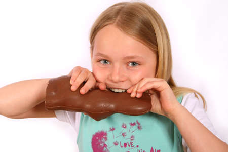 Girl with long, fair hair with a hare of chocolate photo