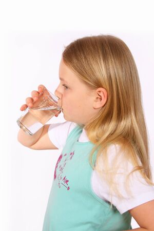 Girl with is drinking a glas of water photo