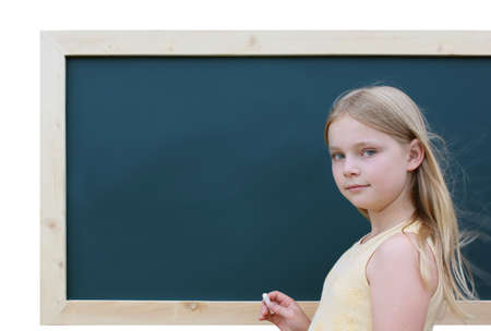 Schoolgirl in front of the blackboard photo