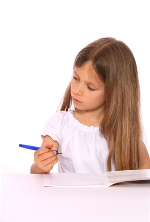 nger: A young girl with long, fair hair is writing with a pen. Stock Photo