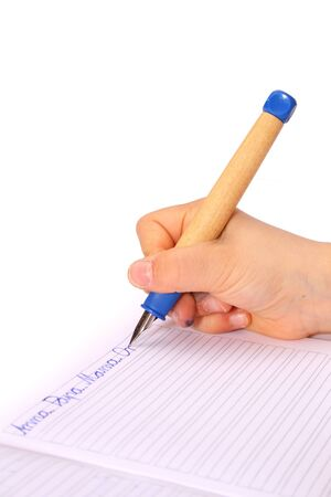 nger: hand of a child with a pen is writing