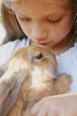 girl with a young rabbit Stock Photo