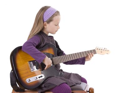 musik: A young girl is playing guitar. Stock Photo