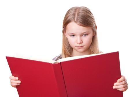ni�os leyendo: chica est� leyendo en un libro grande de color rojo Foto de archivo