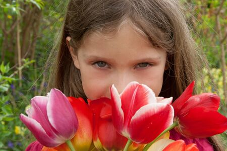 A girl smells of tulips  photo