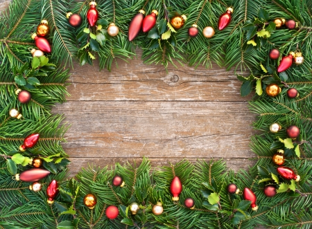 frames and borders: frame with christmas tree balls and fir branches on wooden table christmas decoration Stock Photo