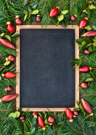 holyday: blackboard with christmas tree balls and fir branches christmas blackboard Stock Photo