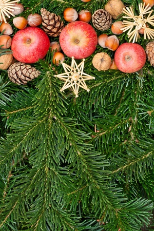 apples, nuts, pine cones, stars and fir branches