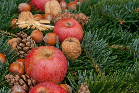 apple christmas: apples, nuts, pine cones, stars and fir branches