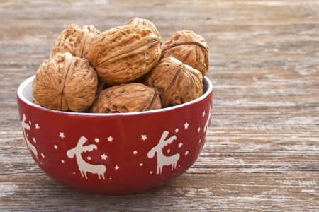 bowl with walnuts on a wooden table