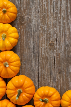 yellow pumpkins on a wooden table