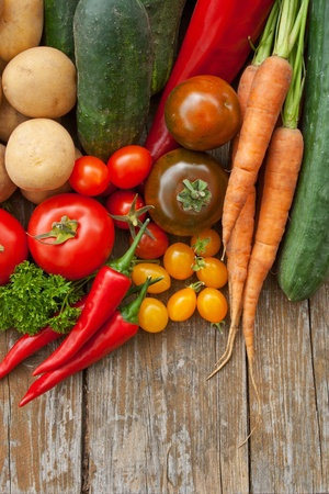 border with vegetables and wooden background Stock Photo - 16623816