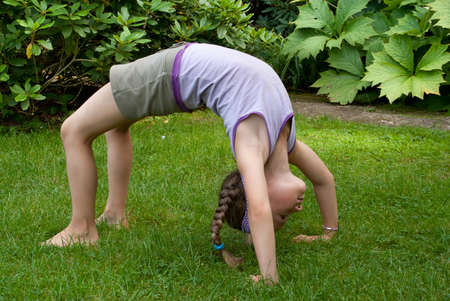 exercices: girlis doing yoga exercice Stock Photo