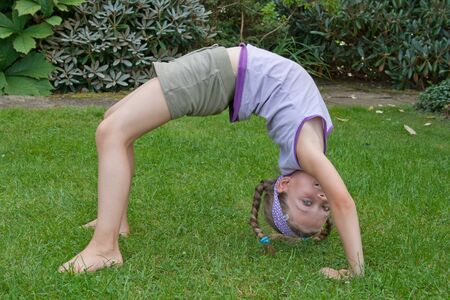 exercice: a young girl is doing yoga exercice Stock Photo