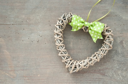 Heart of braided branches with a dotted bow photo