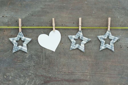 clamps: Checked stars with clamps and green loop on wooden ground Stock Photo