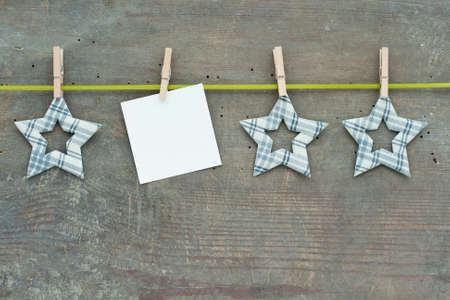 Checked stars with clamps and green loop on wooden ground Stock Photo - 17567793