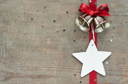 metall texture: red loop, star and bells on wooden ground