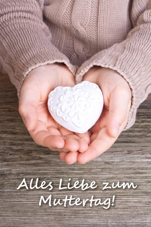 children s: Hands with white heart and lettering mother s day