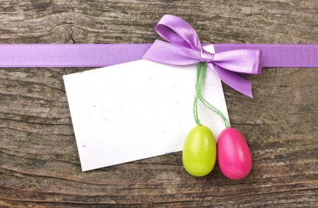Easter eggs, violett loop and card  photo