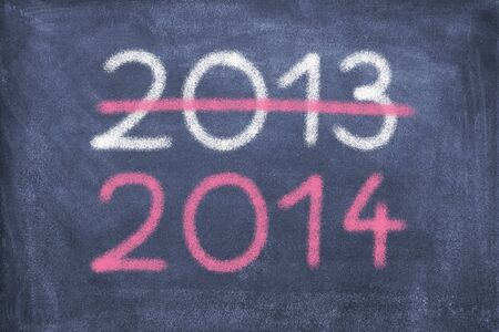 Blackboard with 2013 and 2014 photo