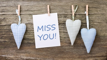 miss you: hearts, close spins and card with lettering miss you Stock Photo
